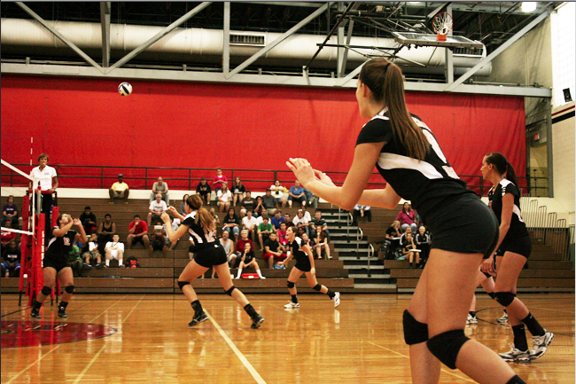 Links Volleyball players work hard, play hard