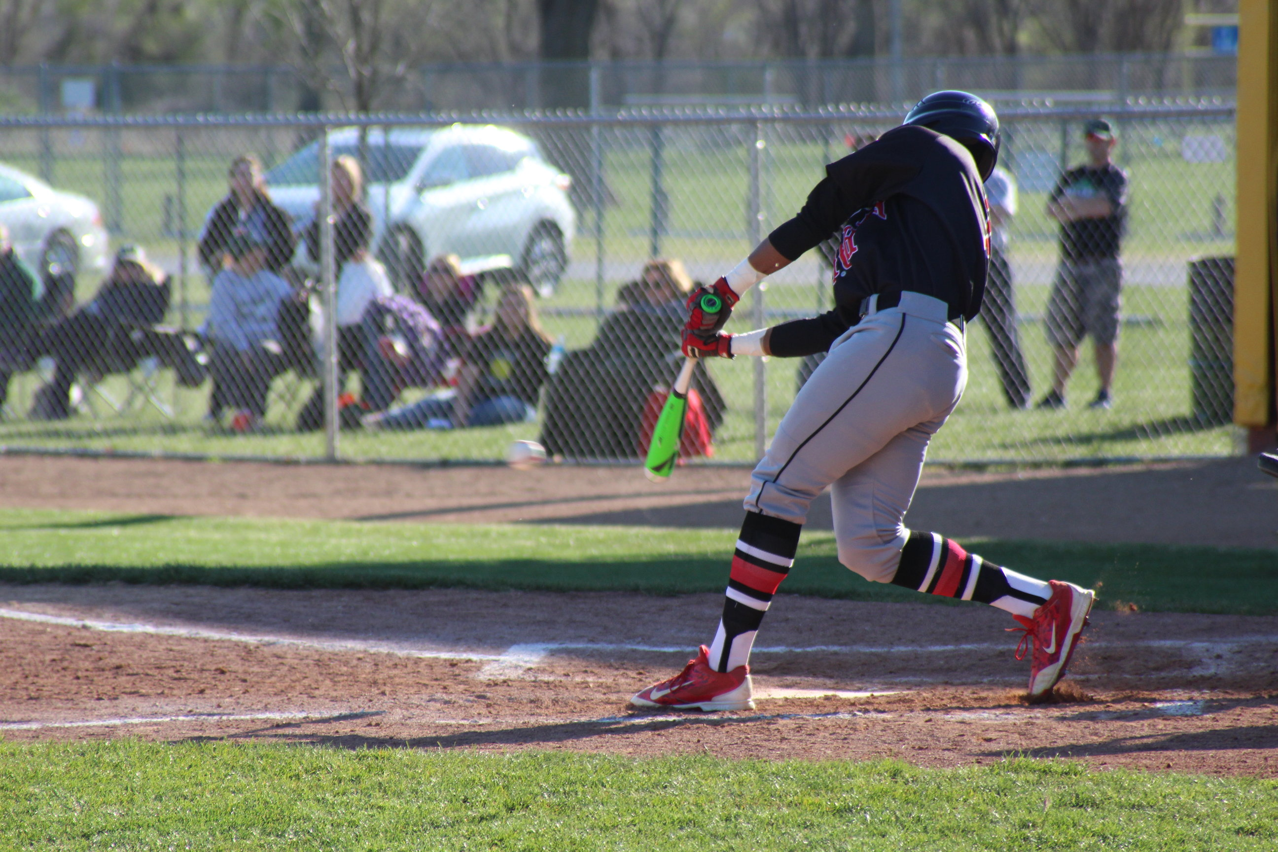 Hitting for the Fences: New baseball coach leads the Varsity Links through the season, builds foundation for years to come.