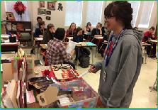 Above: Kaleigh Kaus (12) buys a chocolate bar from english teacher, Deborah McGinn on Friday, October 14th, 2016.