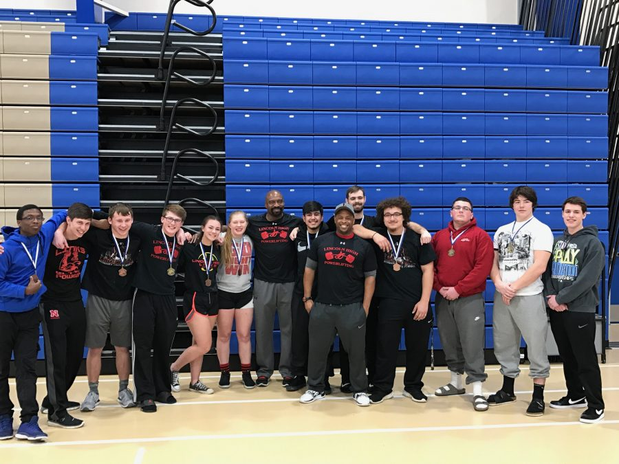 Left:The LHS Powerlifting Team poses for a photo after the Peru State Powerlifting Meet on February 25th, 2017.  From left to right: Reakwon Williams (11), Wyatt Vivier (12), Kyle Dawson (12), Ryen Hanson (10), Alia Cecil (12), Stewart Venable, Brandon Reyes (12), James Watson, Ian Hansen (12), Malachi Norval (11), Mason Sullivan (11), Ron Crouse (10), and Cole Shank (11).