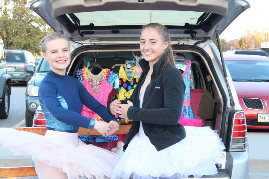 Volunteers, left Whitney Rinemiller and right Lauren Van Treekpose, pose in front of their dance-themed trunk during Key Club's Trunk or Treat event in the LHS parking lot on Oct. 28, 2017. Photo by Meg Boedeker