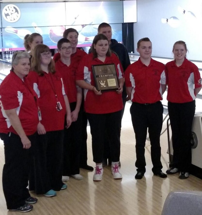 The LHS Unified Bowling Team poses with their District trophy on Tuesday, Nov. 28, 2017. The team will advance to the finals next week. Photo courtesy of Lisa Thiessen
