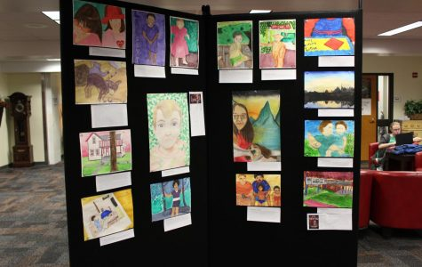 Student artwork hangs on display in the Media Center this week through December 15, 2017 as part of the Art Department's Fall Art show. Photo by Daniel Do