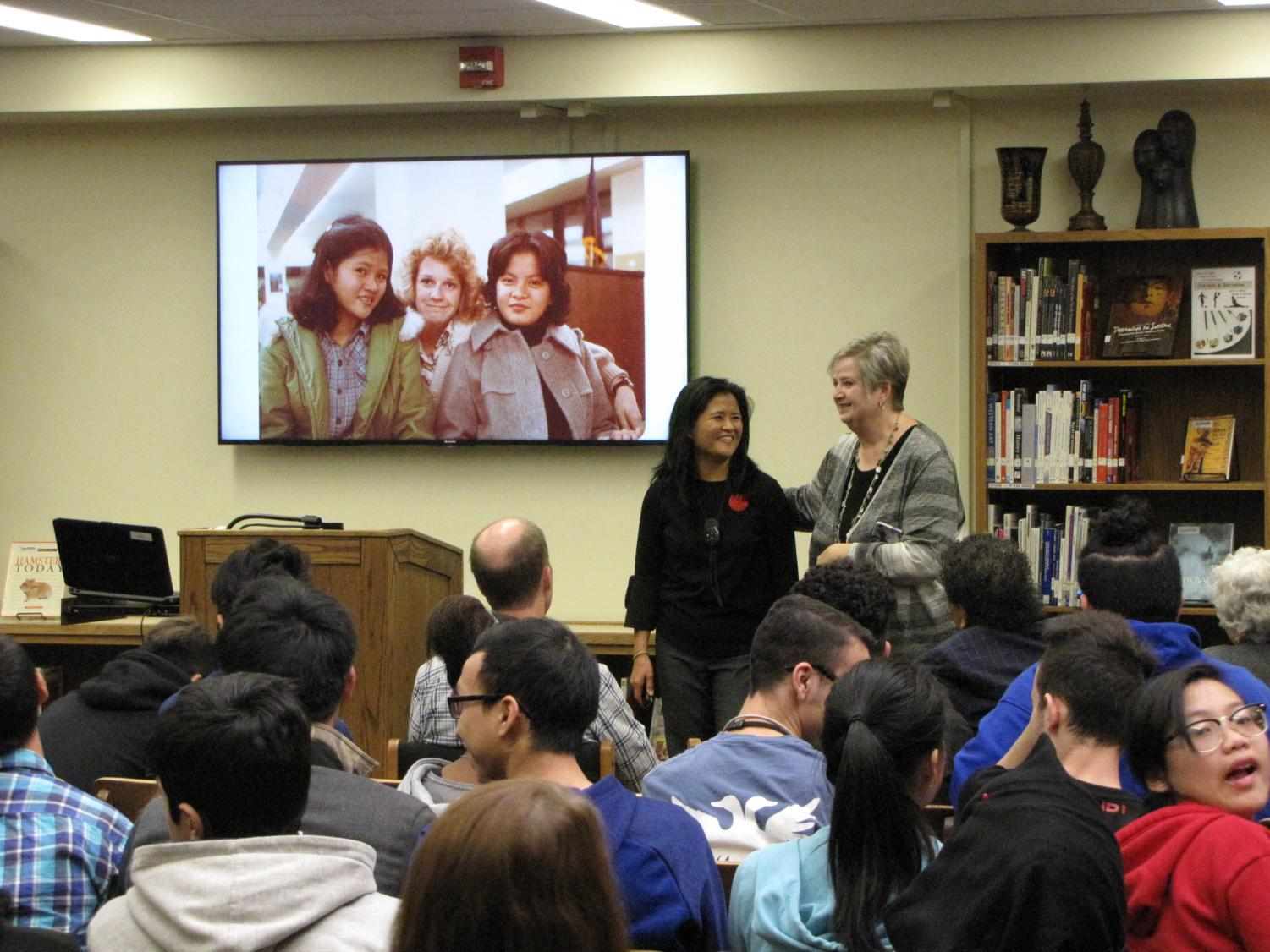Lincoln High alum and author Channy Laux (left) presents her book, Short Hair Detention: Memoirs of a Thirteen-Year-Old Girl Surviving the Cambodian Genocide, on December 19th, 2017 in the Media Center. Photo by Carter Hulinsky.