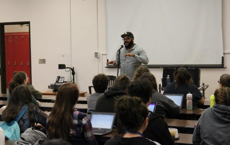 """Nate Marshall, Director of National Programs for """"Louder Than a Bomb"""" slam poetry festival, speaks to Lincoln High students after school on Friday, Jan. 19 in Room 300. Marshall shared his experiences about the festival, read some of his poetry, and answered the students' questions."""