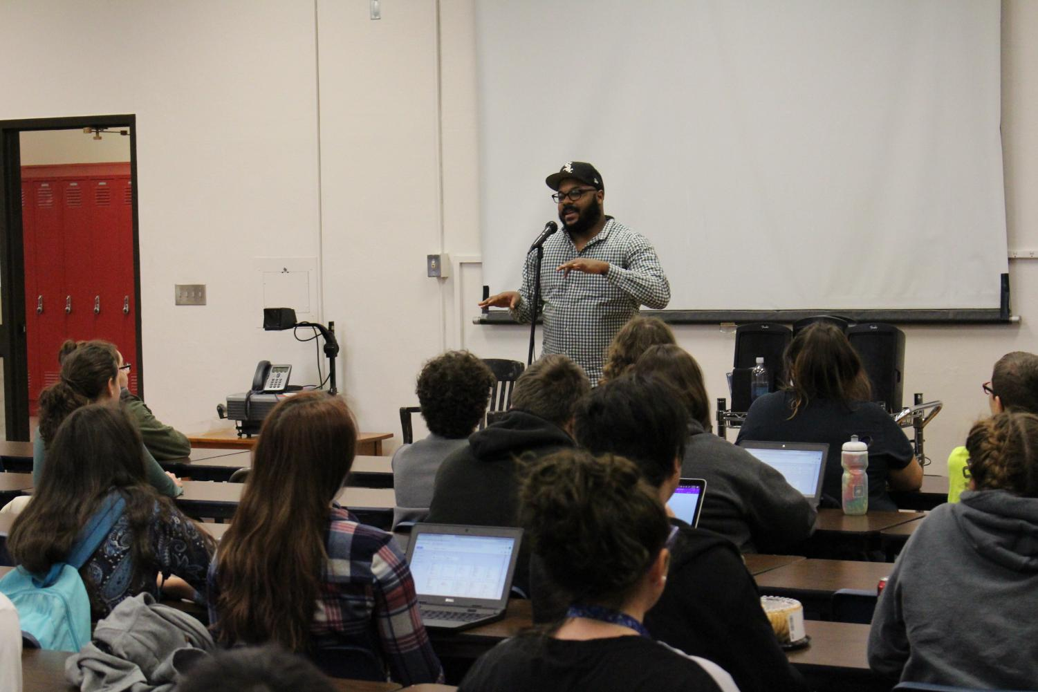 "Nate Marshall, Director of National Programs for ""Louder Than a Bomb"" slam poetry festival, speaks to Lincoln High students after school on Friday, Jan. 19 in Room 300. Marshall shared his experiences about the festival, read some of his poetry, and answered the students' questions."