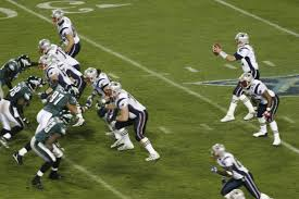 In their last meeting, the Eagles and Patriots played in the 2005 Super Bowl. Tom Brady is set to pass as the Eagles defense tries to get through the initial push of the offensive line for a sack. Photo Courtesy of Wikimedia Commons.