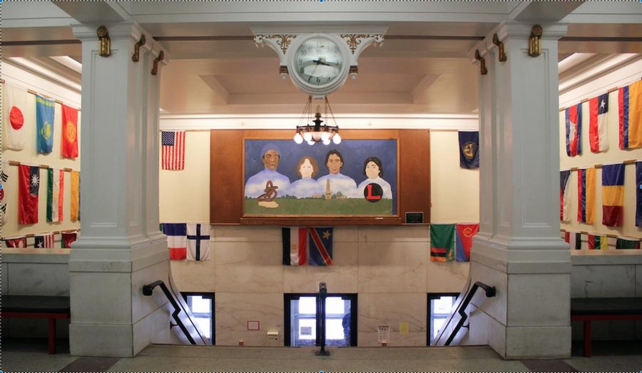 The entrance of Lincoln High School features flags and a mural that represent the school