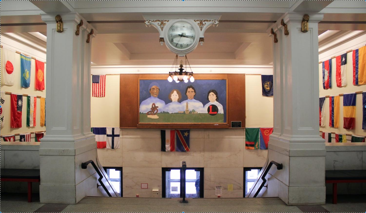 The entrance of Lincoln High School features flags and a mural that represent the school's diversity. Photo by Sara Balter.
