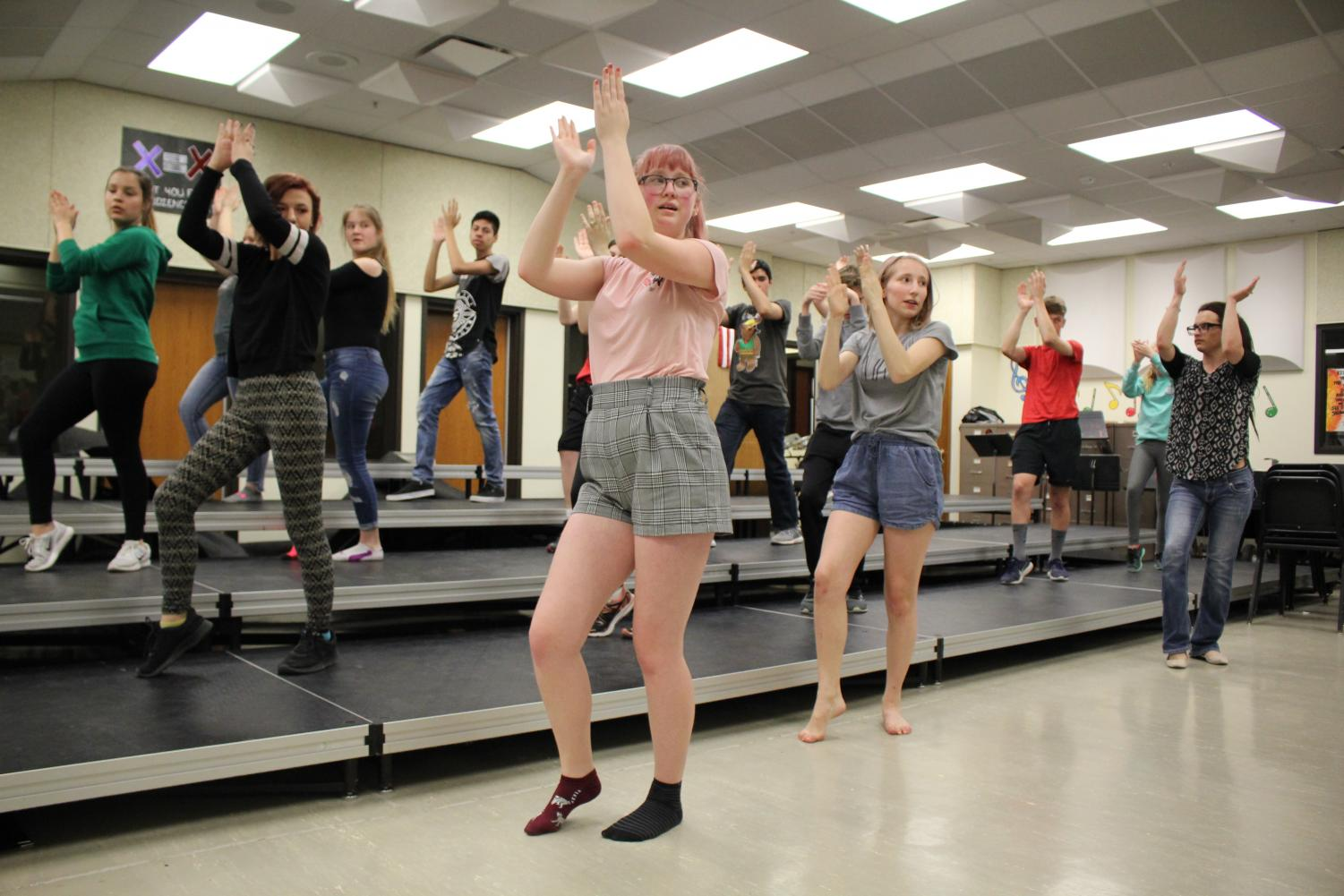 Emily Price (11) and Reagan Gordon (9) help lead the show choir dance workshop through the week of April 23. Photo by Audrey Perry