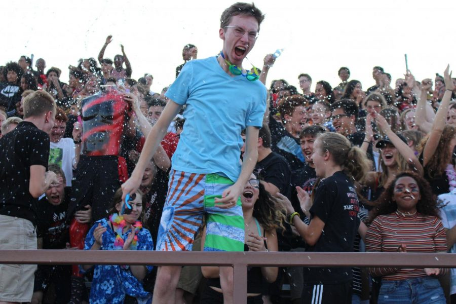 Carter Yost(12) dressing up for the Beach theme, at the first home game of the season, against Grand Island on August 31, 2018. Photo by Emily Price