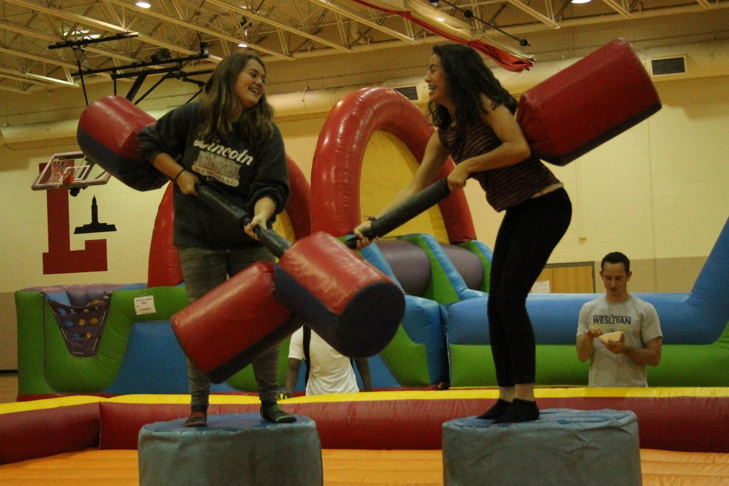 Students Cameryn Bratcher-Rosekrans (10) and Maria Garcia Castorena compete in the Joust Tournament at last year's Festivus. Food and activities are back for this year's celebration on Friday, Sept. 14, 2018. Photo by Maria Izaguirre