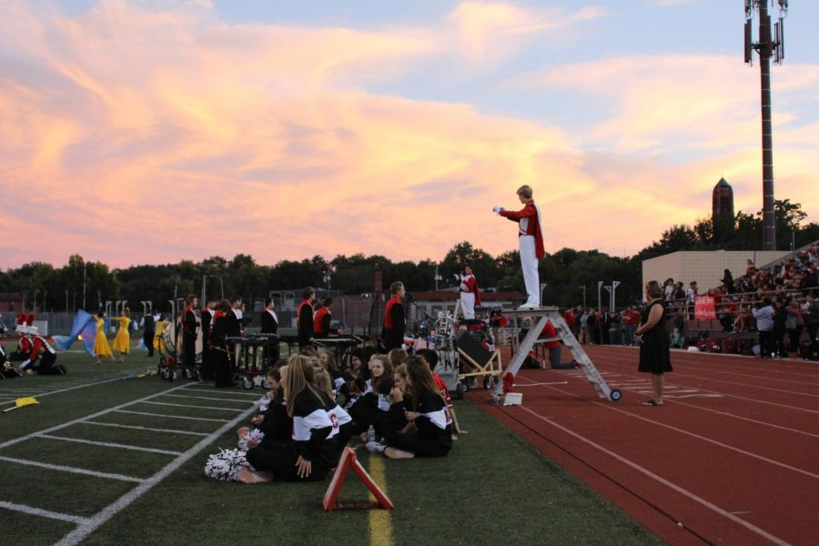 The+sky+provides+a+dramatic+backdrop+as+Drum+Major+Luke+Moberly+%2811%29+leads+the+LHS+Marching+Band+in+a+song+at+the+Homecoming+football+game+on+Friday%2C+Sept.+21%2C+2018+at+Beechner+Athletic+Complex.+Saxophone+player+Jacob+Vanderford+%2811%29+sings+a+solo+during+the+performance.+The+Links+defeated+Omaha+Central+49-6.+Photo+by+Anthony+Torres