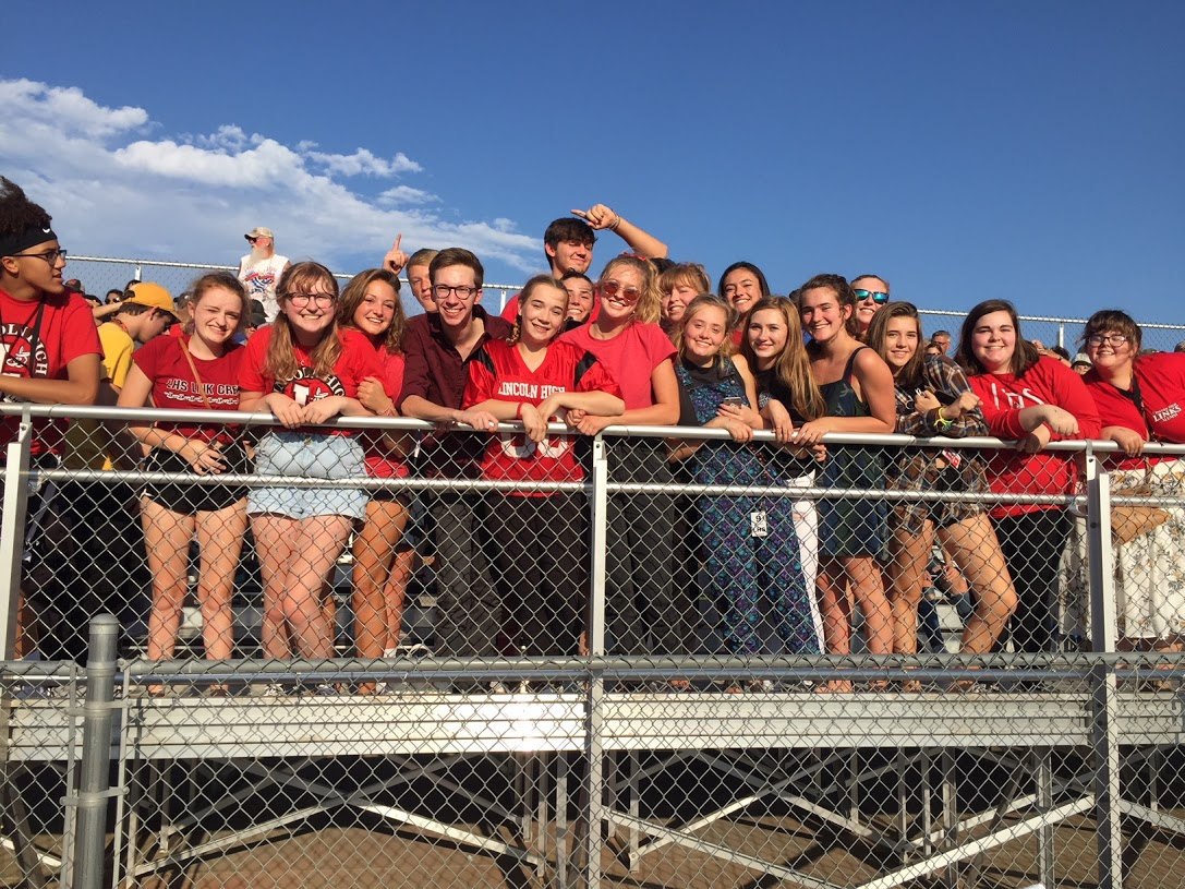 "A sea of red appeared at the Freshmen Football game at Lincoln Southwest compliments of ""UNITY!"" a new informal student group. These students led chants and cheered on the Links throughout the game on August 30th."