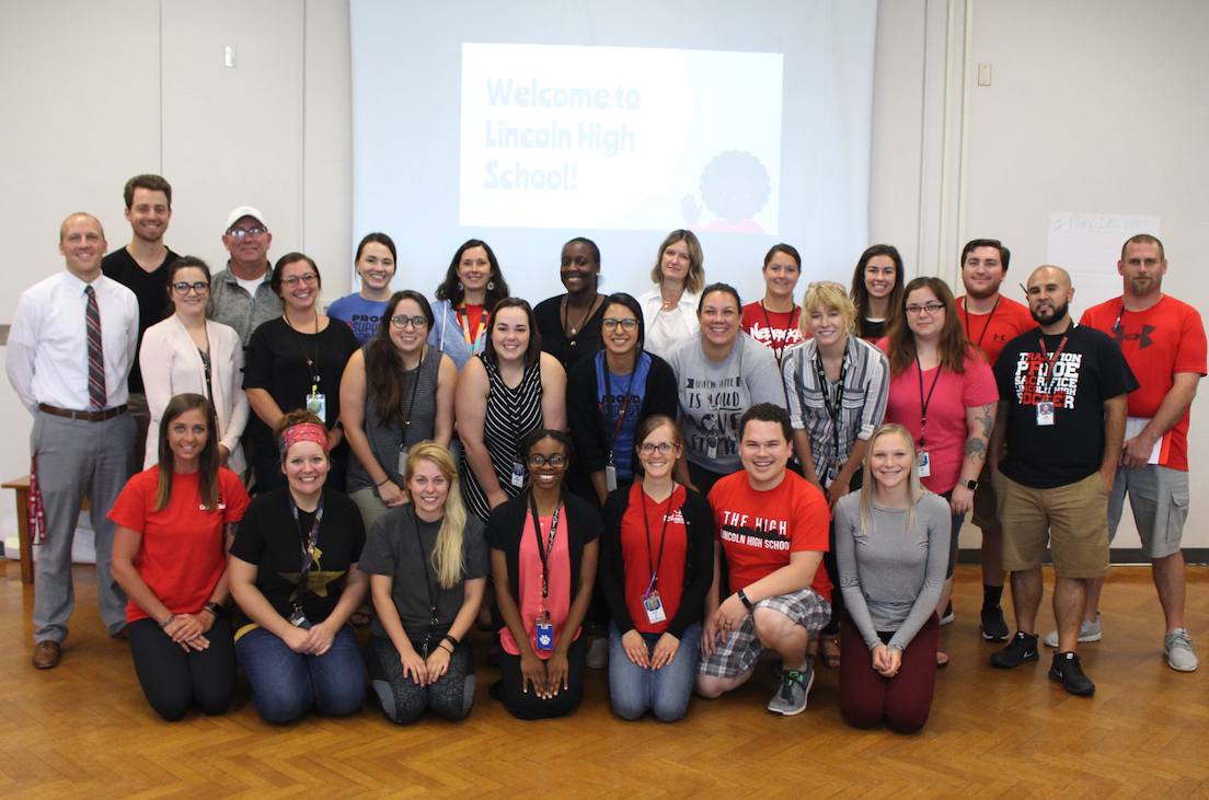 New teachers and staff pose for a photo during a training before the new school year.   FRONT ROW (Left to Right): Candace Robertson (PE); Shelbi Bretz (English); Audrey Augustine (Math); Mar'Lakuittia Overstreet (ELL); Kami Lee (Art); Zach Mapes (WL/Math); Kendra Alberts (SPED)  CENTER ROW (Left to Right):  Jon Davidson (Admin); Rachel Scheet (Science); Lindsey Coit (Science); Holly Stejskal (English); April Blackledge (SPED); Brenda Lopez Adame (WL); Carissa Stock (SPED); Lydia Cotton (FACS); Kayla Munoz (WL); Adan Martinez (Counseling)   BACK ROW (Left to Right): Jordan Pullen (WL); Michael Powell (SPED); Nicole Ellison (English); Carol Flora (SS); Dominique Kelley (English); Kirsten Huddleston (SS); Shannon Gusso (SPED); Courtney Fasbender (Math); Joe Cortese (PE); Kevin Prai (STS)