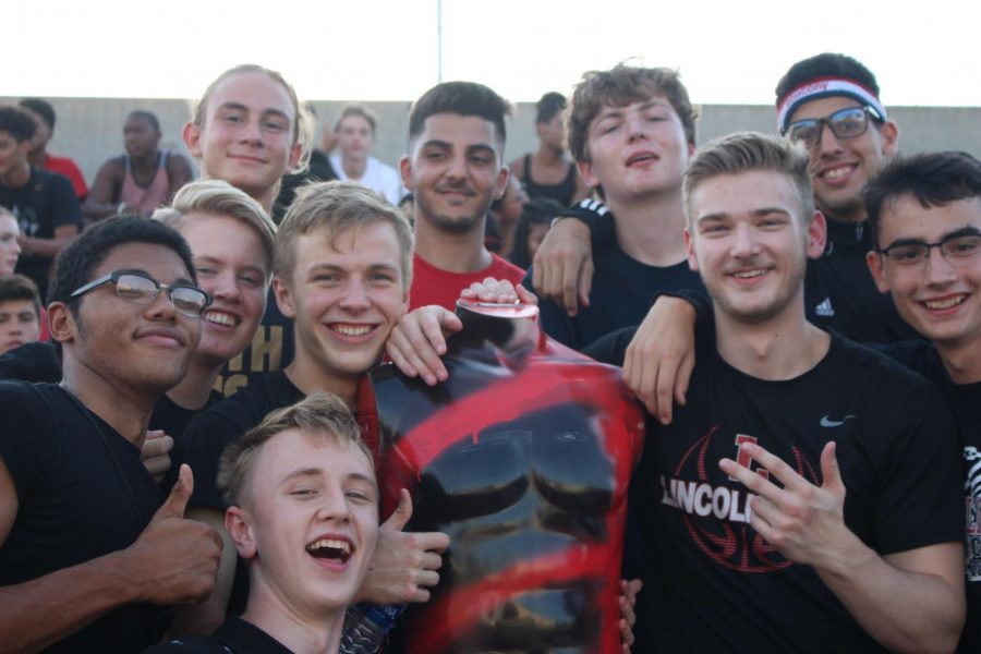 Humphry poses for a photo op. with his posse in the student section at the Lincoln High versus Grand Island football game at Beechner Athletic Complex. If he had a head, he'd be smiling as well.
