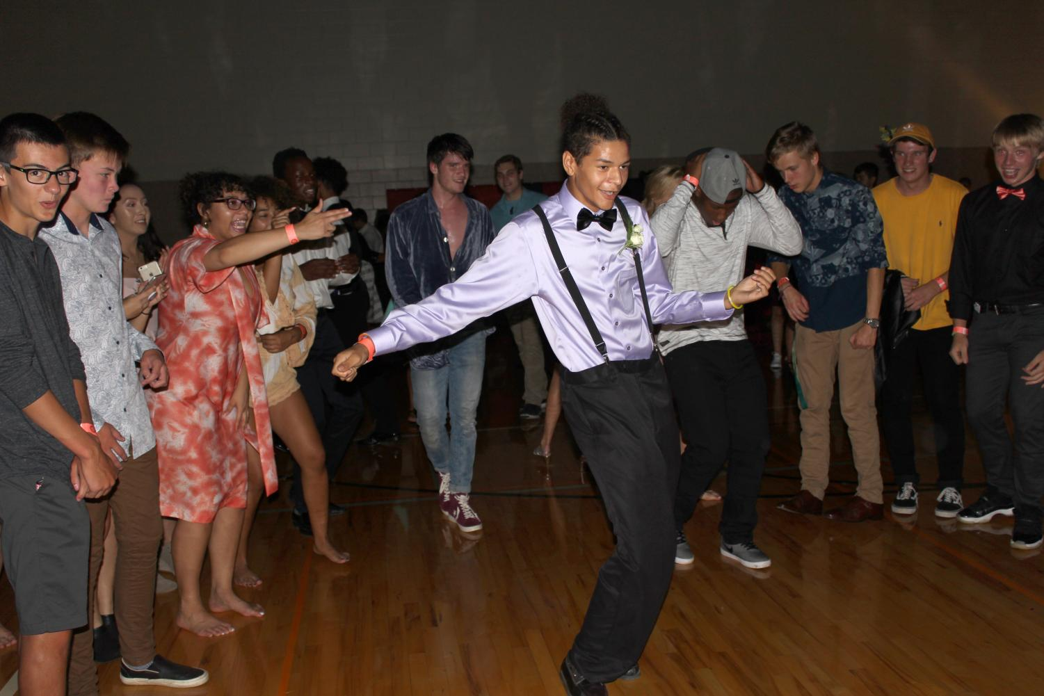 Levelle Foster (9) gets his grove on during the Friday Night Fever Homecoming Dance on Friday, Sept. 21, 2018 while other students cheer him on.  Photo by Clementine Ewomsan.