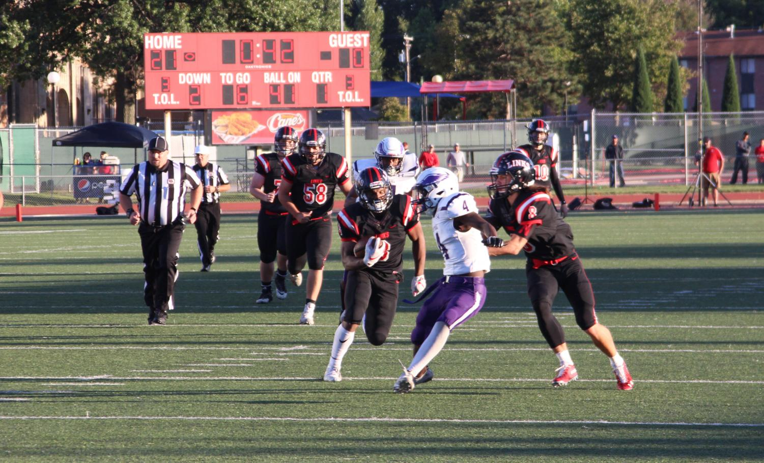 #3 Isaiah Alford runs the ball during the game against Omaha Central at Beechner Athletic Complex on Friday, September 21st, 2018. Photo by Zeke Williams
