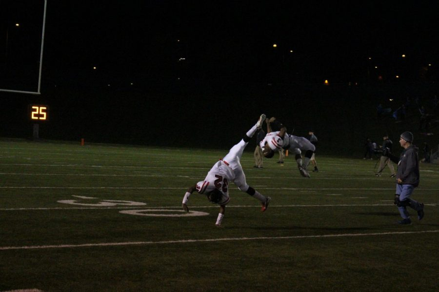 #32 Morgan Perry(12) and #3 Isaiah Alford(12) cartwheel and flip across Seacrest field, Friday October 19th, after a 43-3 victory against Lincoln Southwest. Photo by Zeke Williams.