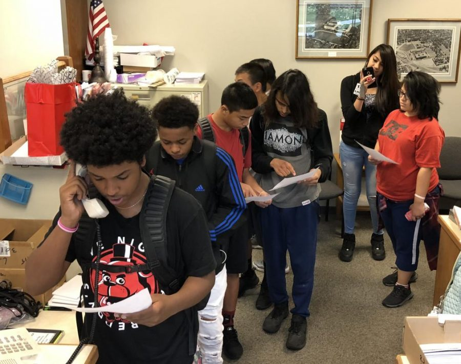 Native American Caucus students prepare to read over sound announcements regarding Columbus Day during the 1st week of October.