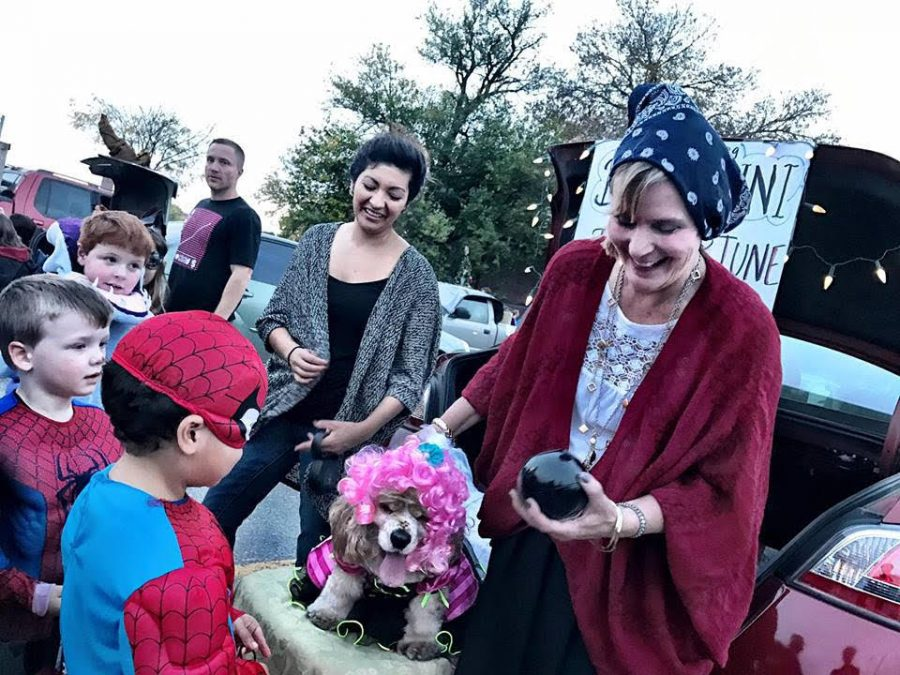 LHS+counselor+and+Key+Club+sponsor+Judy+Tuttle+gives+out+candy+to+a+child+dressed+as+Spiderman+at+the+2017+Trunk+or+Treat.+Advocate+File+Photo
