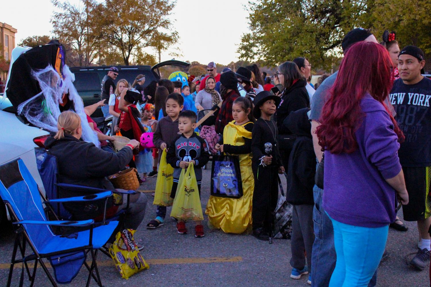 Kids from all around Lincoln attend Trunk or Treat and receive candy on October 27th, 2018.