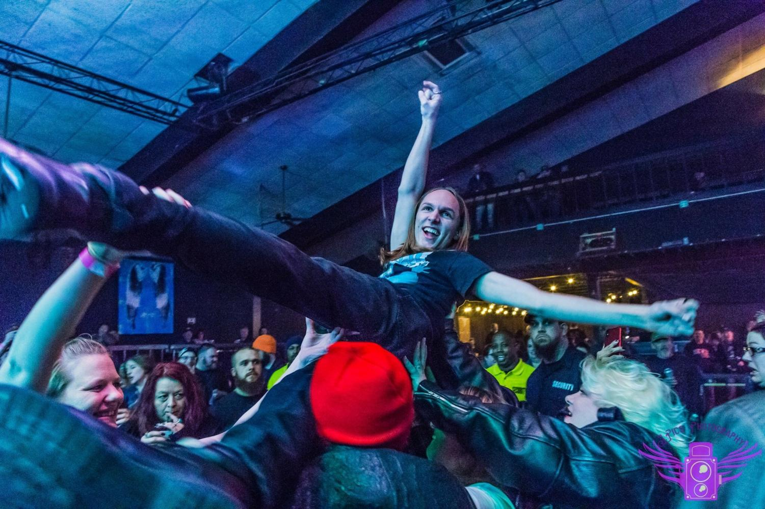 Lincoln High musician Will Gades (12) gets a little wild, as well as very trusting, during one of his shows and surfs the crowd of an overflowing venue. This is a regular occurrence for his shows.