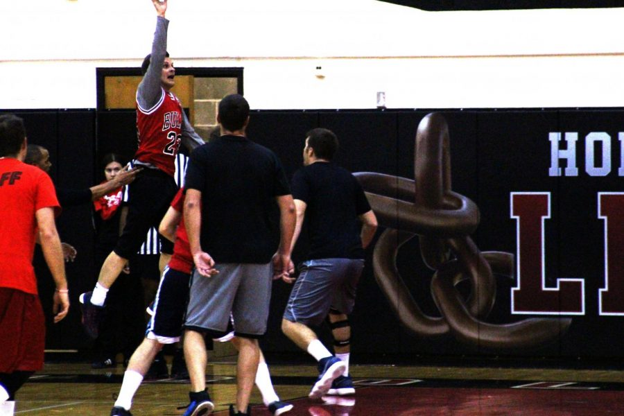 Red and Black team attempt to get the ball back after an air ball at Hoops for Hope, on November 1st, 2018. Photo by Zeke Williams