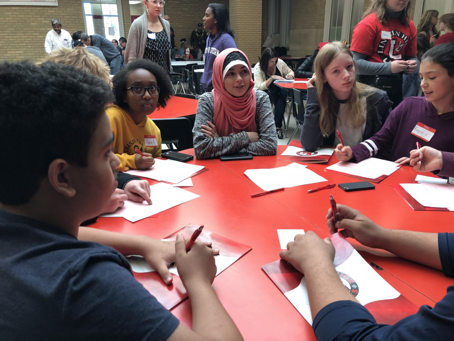Possible future Pre-IB students gather at tables in the cafeteria in Lincoln High at IB Academy Day on October 27th, 2018. Advocate staff photo.