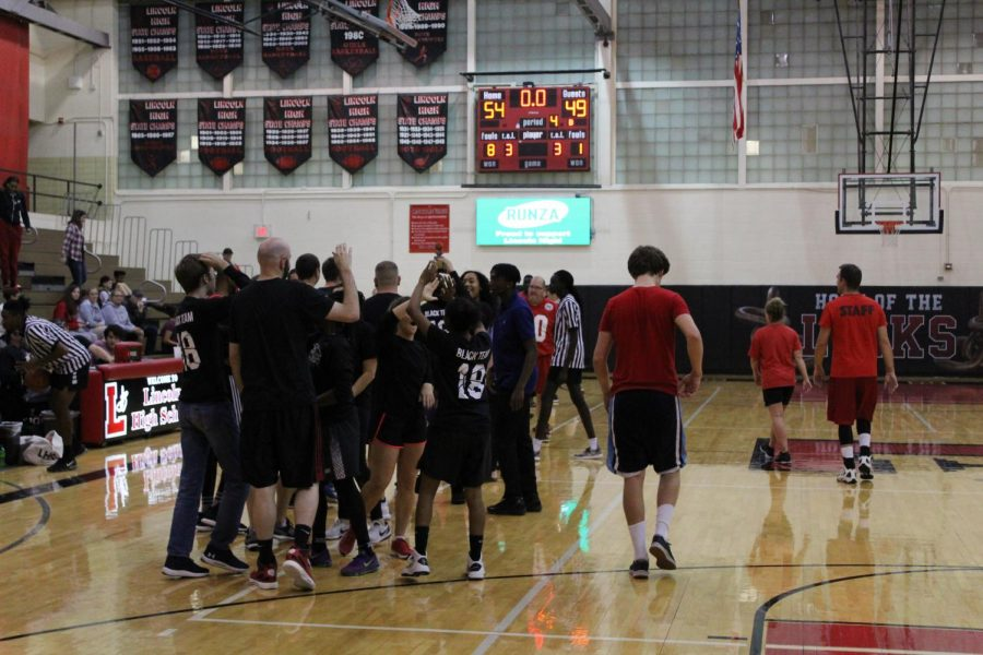After a close game in Johnson Gym on November 1, 2018 the Black team hold victory over the Red team Photo by Anthony Torres