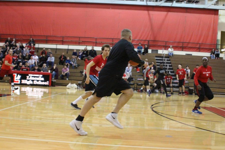 Business Teacher Dan Noble attempts to score for the Black Team at Hoops for Hope, November 1st, 2018. Photo by Zeke Williams