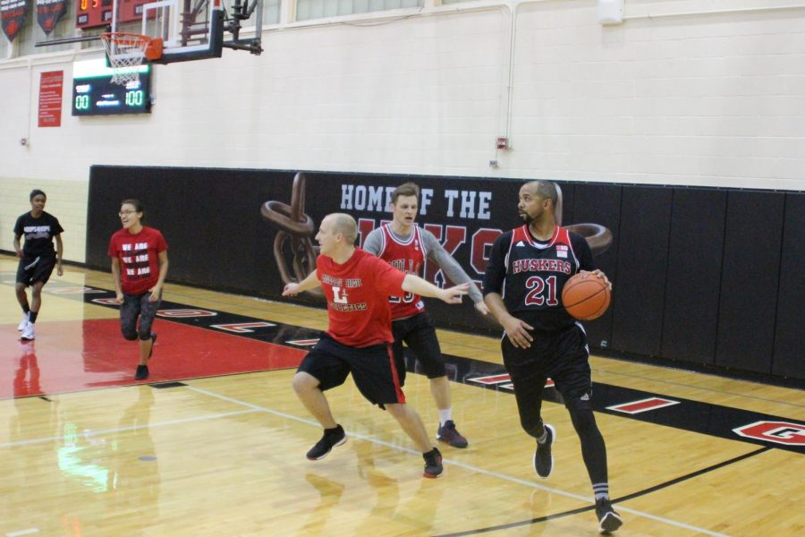 Attendance Technician Montsho Wilson keeps the ball away from the Red team, on November 1st, 2018. Photo by Zeke Williams