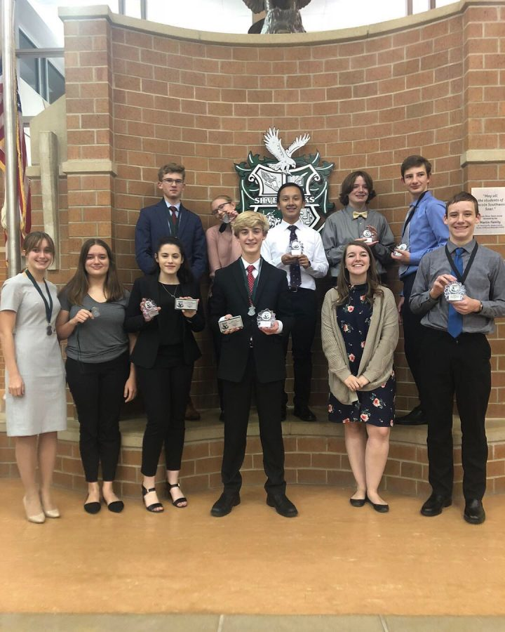 The+LHS+Debate+team+poses+for+a+photo+with+their+awards+at+Lincoln+Southwest+High+School.+Courtesy+of+Luke+Moberly+%2811%29.