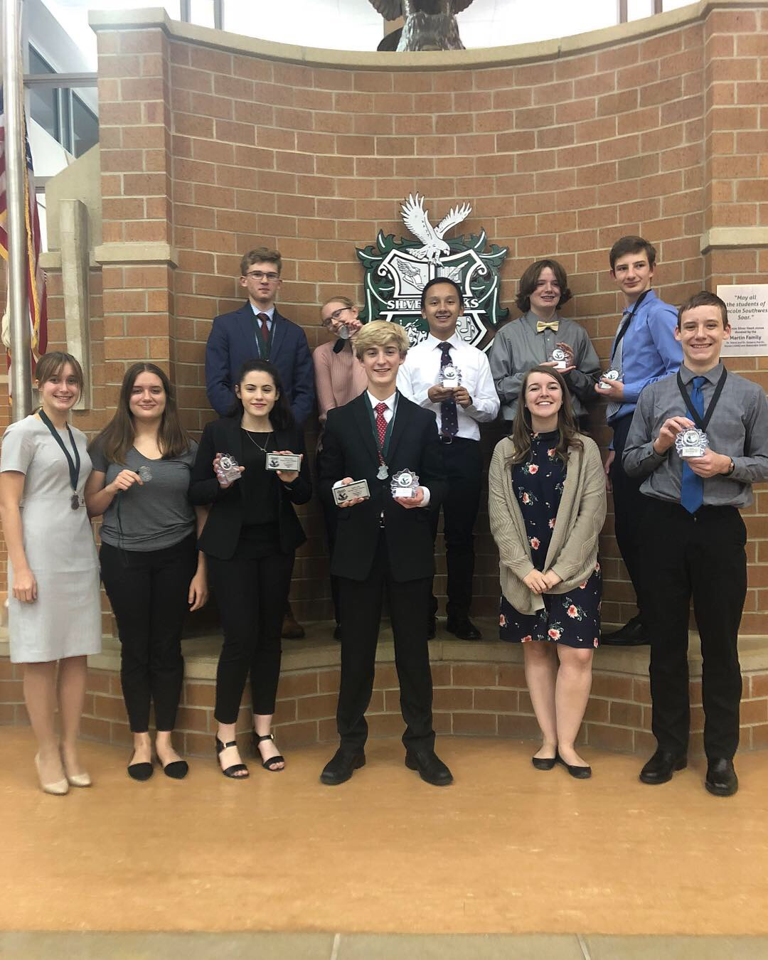The LHS Debate team poses for a photo with their awards at Lincoln Southwest High School. Courtesy of Luke Moberly (11).