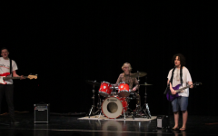 The rock band Smells Like Bold preforms at Joy Night 2018 on May 11, 2018. Ethan Rask (10), Vincent Welsh (10) and Emerson Borakove (10) are the preforming members. Photo by Livia Holbert