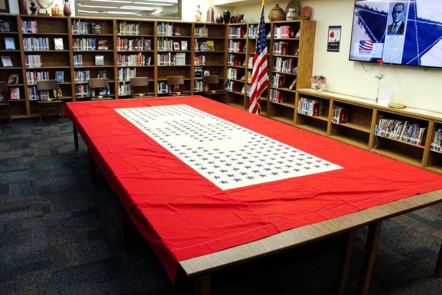 A banner from the early 1900s lays on a table in the east wing of Lincoln High's Media Center on November 11th, 2018. Photo by Zeke Williams.