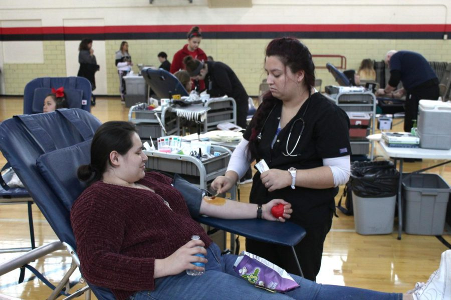 Rinn+Rogers+%2812%29+prepares+to+donate+blood+on+January+25th%2C+2019.+This+was+the+Red+Cross+Club%27s+second+blood+drive+of+the+year.+Photo+by+Zeke+Williams