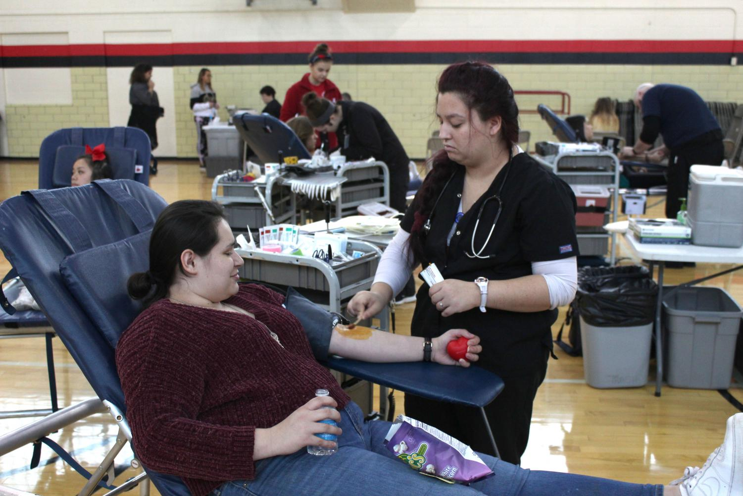 Rinn Rogers (12) prepares to donate blood on January 25th, 2019. This was the Red Cross Club's second blood drive of the year. Photo by Zeke Williams