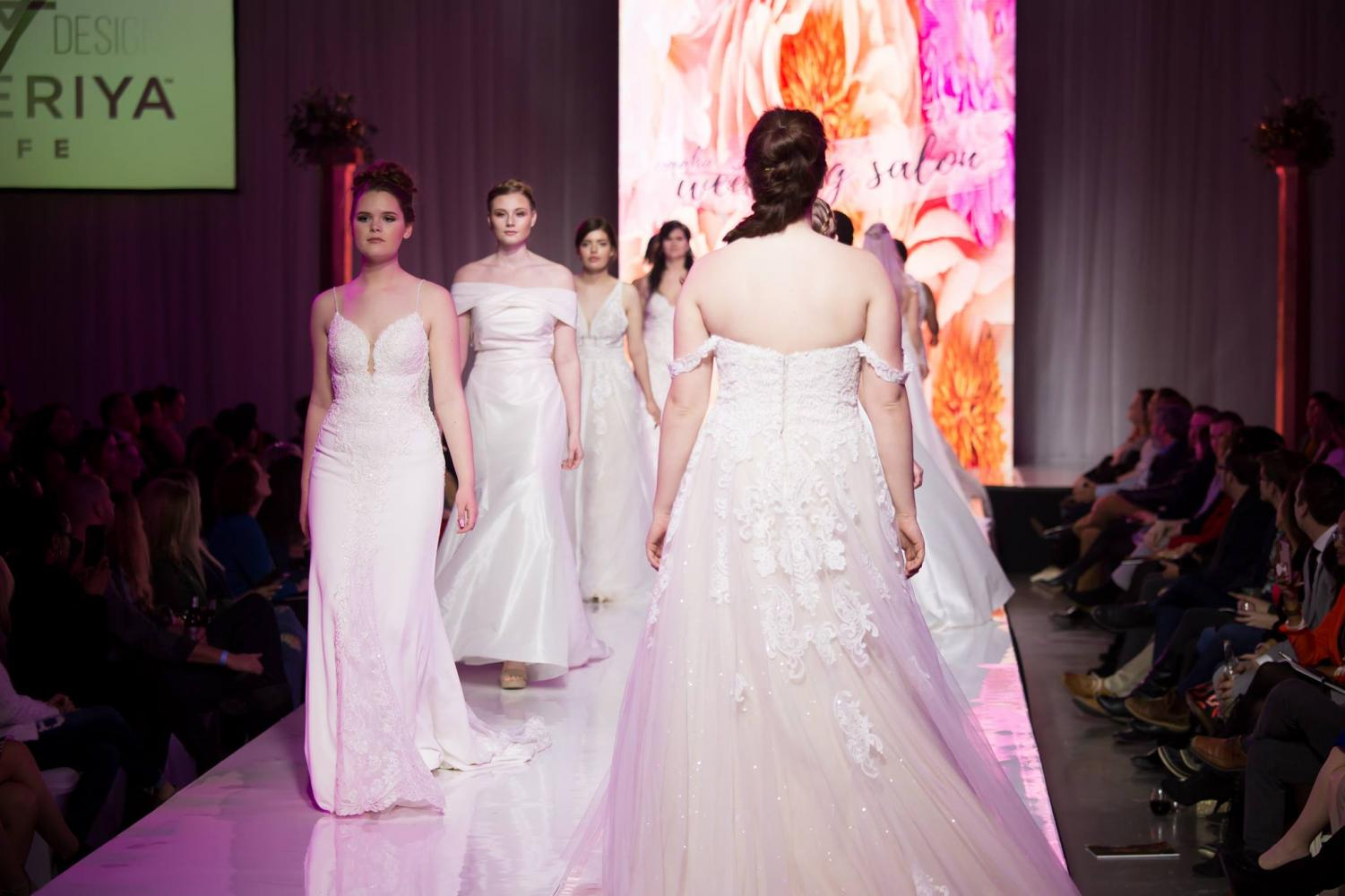 Models walk the runway during Wedding Night on Monday, February 25th in gowns. Photo courtesy of Omaha Fashion Week. Photo by Heather and Jameson.