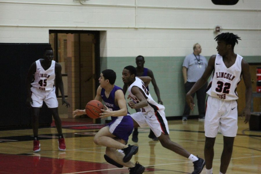 Keyshawn Jenkins(12) guards an Omaha Central player on January 12th, 2019. The Links are to play Central tomorrow, February 26th at 6 p.m. at Central. Photo by Zeke Williams