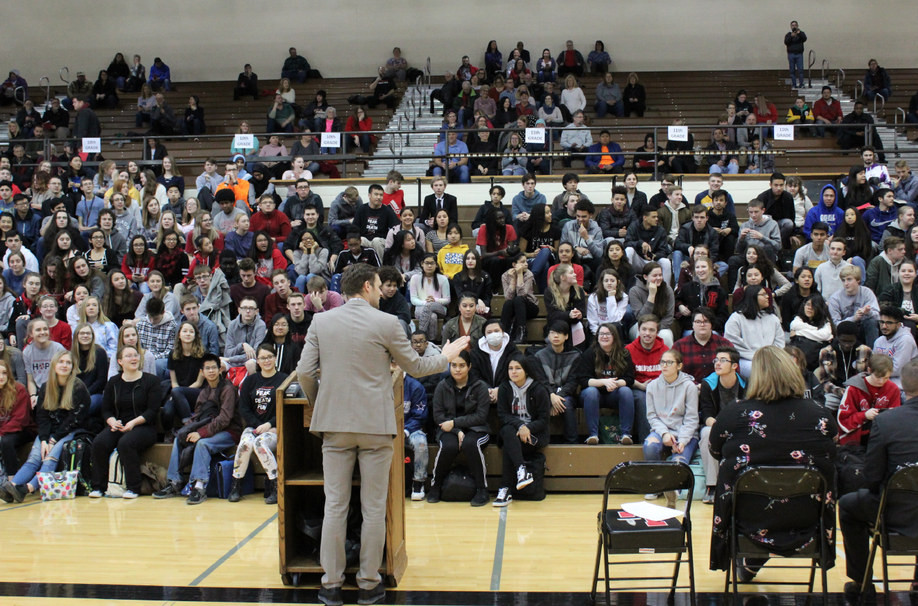 Lincoln High principal Mark Larson addresses the students and guests assembled in the Johnson Gym on Thursday, Feb. 7, 2019 for the Honors Assembly. The ceremony had to be moved from the Ted Sorensen Theatre to accommodate the large numbers this year. Photo by Emily Price