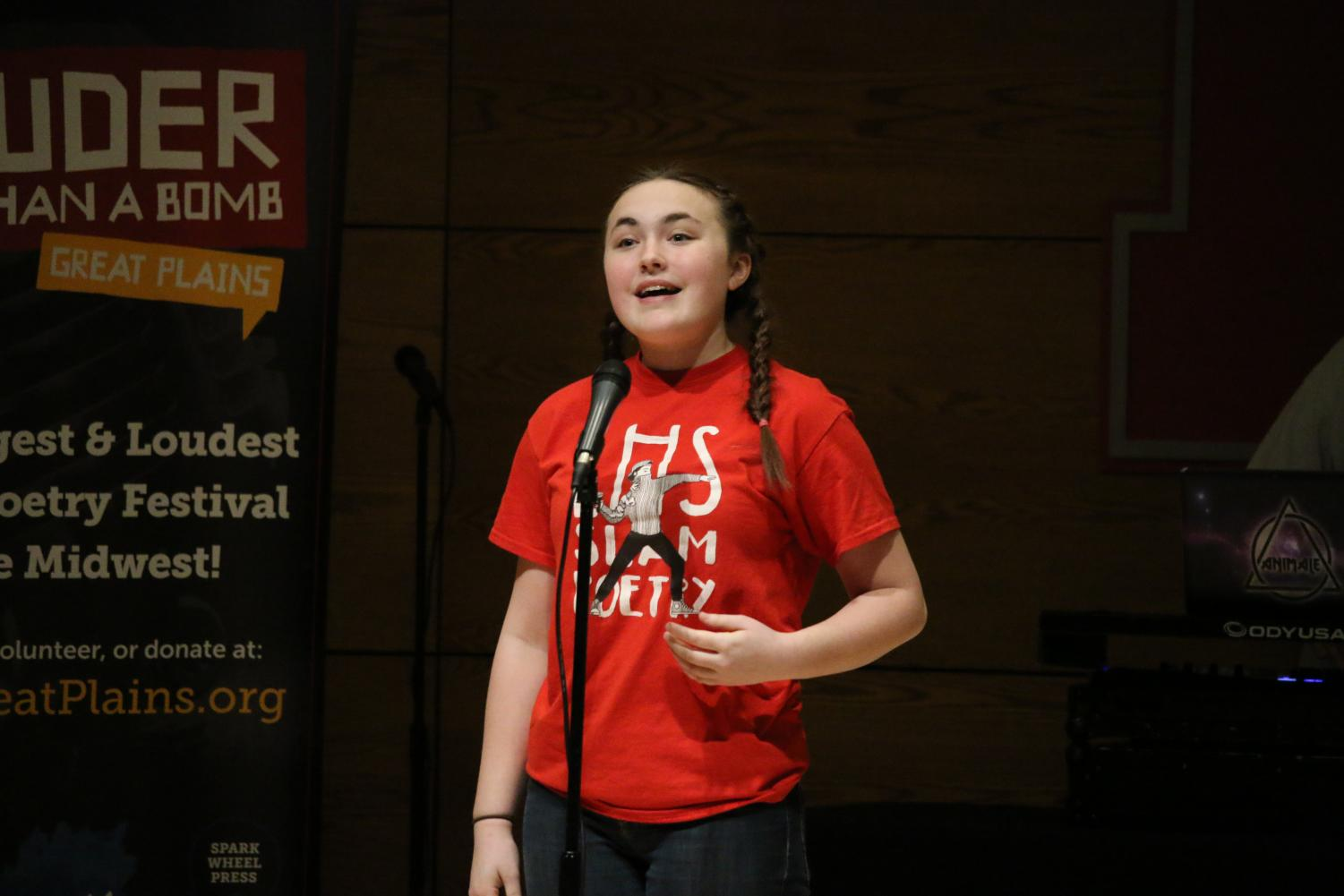 Sophomore Samantha Roblyer performs at last year's Louder Than a Bomb state competition. Photo by Carson Allen.