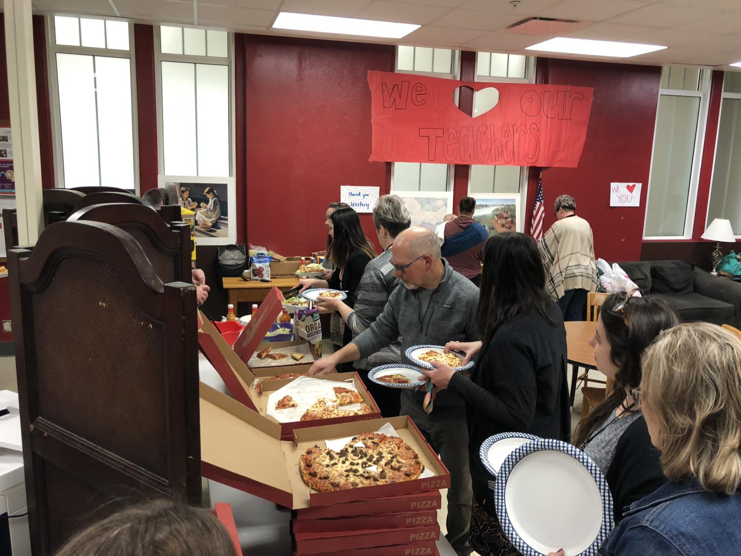 Teachers help themselves to pizza, salad, and dessert in the Teachers Lounge provided by the LHS Booster Club before Parent/Teacher Conferences this past Wednesday, Feb. 27, 2019. Conferences were rescheduled to tonight from last week due to a snow day. Advocate Staff photo