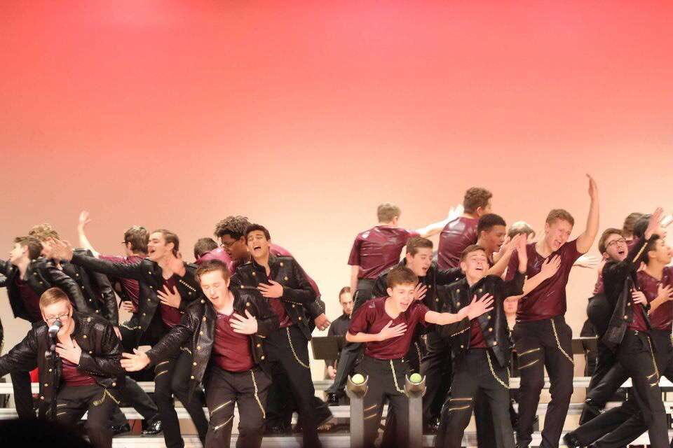The men of Momentum, Lincoln High's varsity show choir, perform