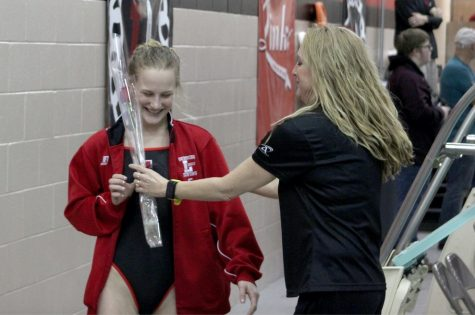 Senior Colleen Arnold receives a rose from Assistant Coach Sharill Luedtke on Senior Night at the Swimming and Diving meet at LHS on Jan. 29, 2019. Photo by Zeke Williams