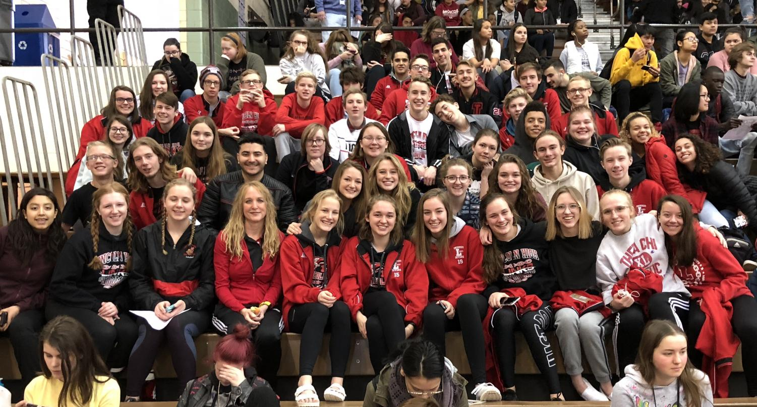 The Varsity Swim Team sits together at the Winter Pep Rally. The team will leave early to compete at Districts in Fremont.