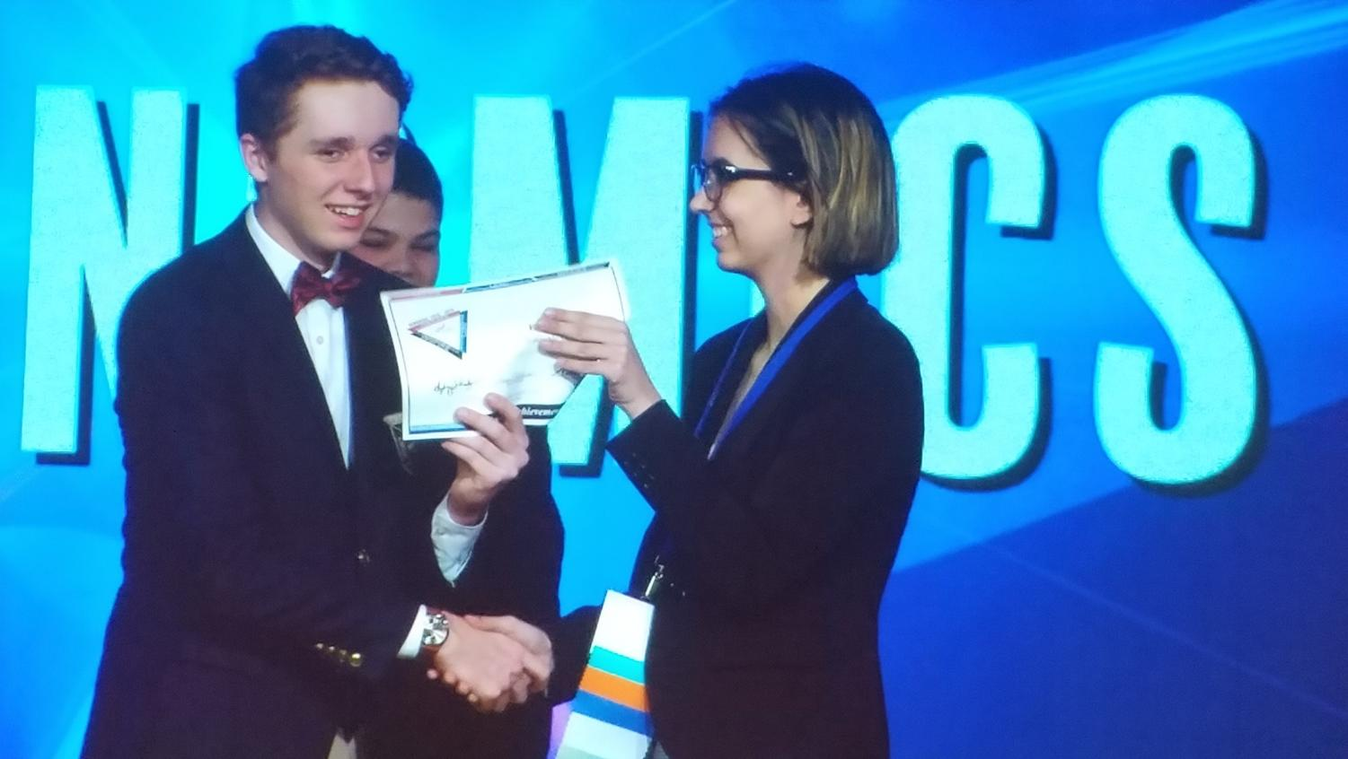Senior Chloe Andreini receives a honorable mention certificate during the FBLA State Leadership Conference Awards Ceremony on April 16th, 2019.  Andreini received her certificate in Economics and will compete at nationals in June in San Antonio, Texas.  Photo courtesy of Bonnie Anderson