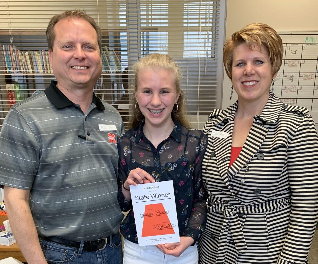 Lauren Moon (10), poses with her award from Google's Science Fair along with her mother Deanne Caspers-Moon, and her father Rich Moon in the LHS Counseling Center on April 5th, 2019. Her parents surprised her at with the award at school. Photo courtesy of Niki Barnes