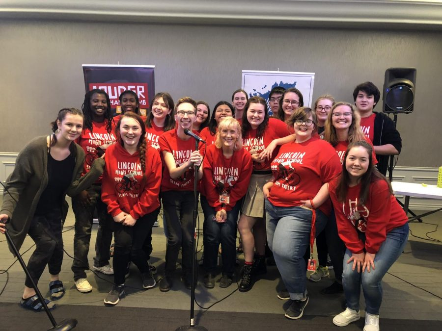 The Slam Poetry team poses for a photo at UNO's Thompson Alumni center after winning their second bout on April 1st. 2019. They will be heading to the Semi Finals where they will compete to perform at the Finals. Photo courtesy of Deborah McGinn