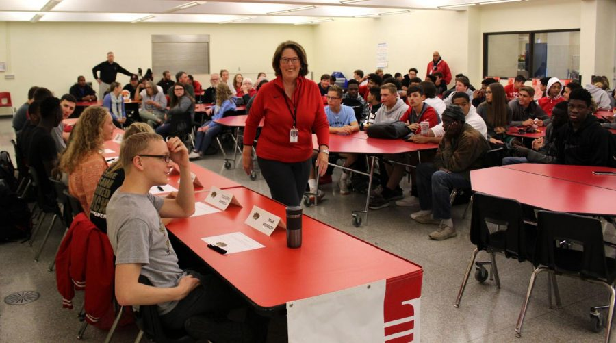 Students, staff, and families gather in the LHS cafeteria on Tuesday, May 7th, 2019, for spring signing day. 10 students signed, three for swim and dive, one for soccer, three for basketball, two for football, and one for baseball. Photo by Zeke Williams